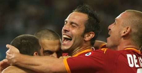 Perrotta is congratulated by his Roma team-mates