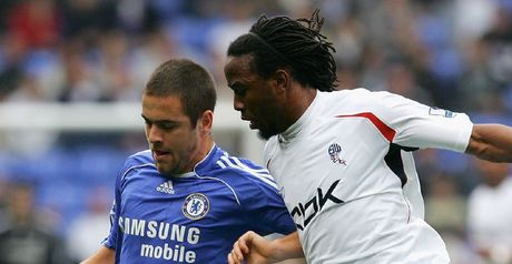 Joe Cole challenges Ricardo Gardner for the ball