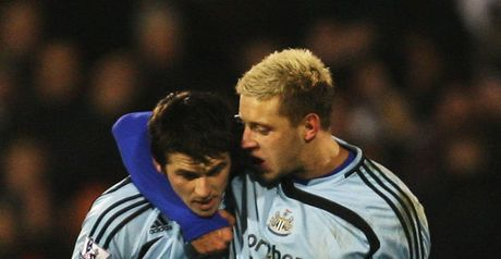 Barton is hugged by Alan Smith after his late winner