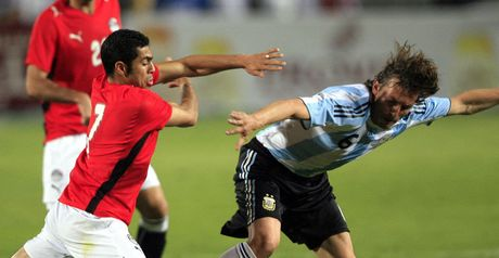 Egypt's Ahmed Fathi fights for the ball