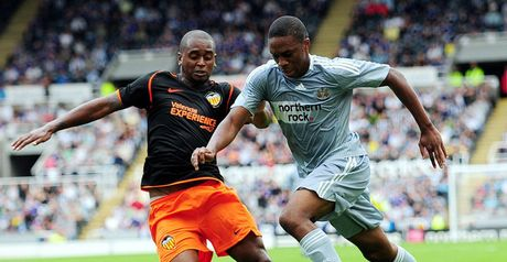 N'Zogbia surges past Miguel