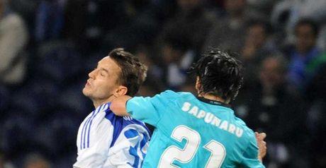 Challenge: Porto's Cristian Sapunaru rises with Milos Ninkovic