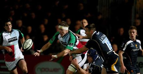 Harlequins lock Jim Evans releases the ball in traffic