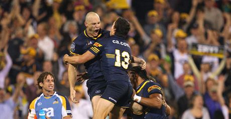 Mortlock celebrates with his Brumbies team-mates