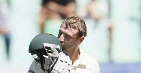 Hughes kisses his helmet after reaching a maiden Test century