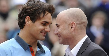 Slam success: Federer is congratulated by Andre Agassi following his French Open win