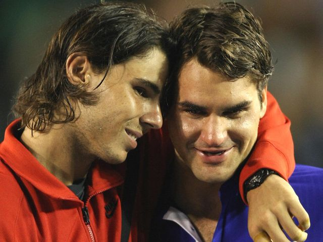 Nadal consoles Federer after their 2009 classic