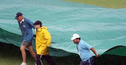 Under cover: busy day for the groundstaff