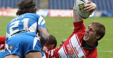 Tomkins: Celebrates scoring one of Wigan's five tries
