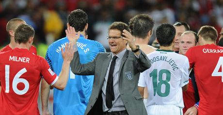 Cap that: Fabio Capello celebrates England's win with his players