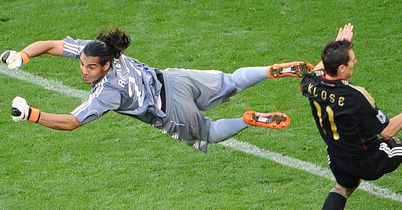 Romero: In action for Argentina as he thwarts Germany's Miroslav Klose