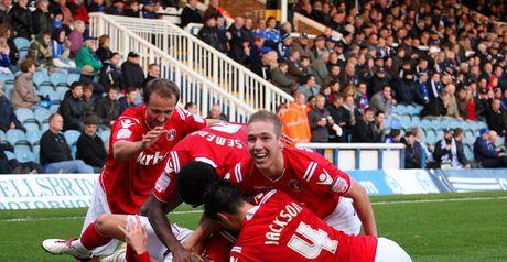 Martin: Mobbed by his team-mates after scoring