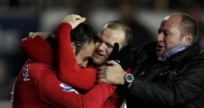 Berbatov: Celebrates with Rooney after putting United in front