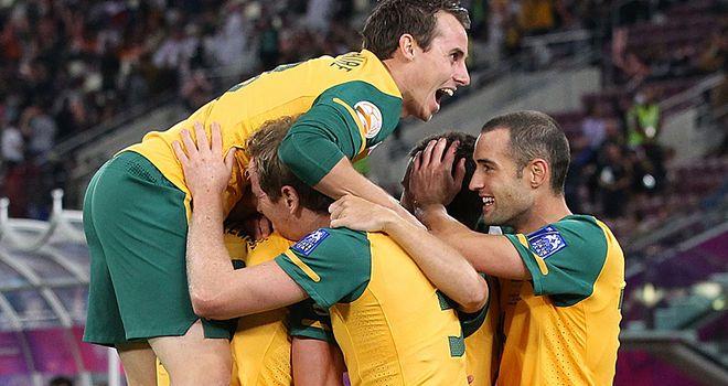 Australia celebrate Kewell's opener