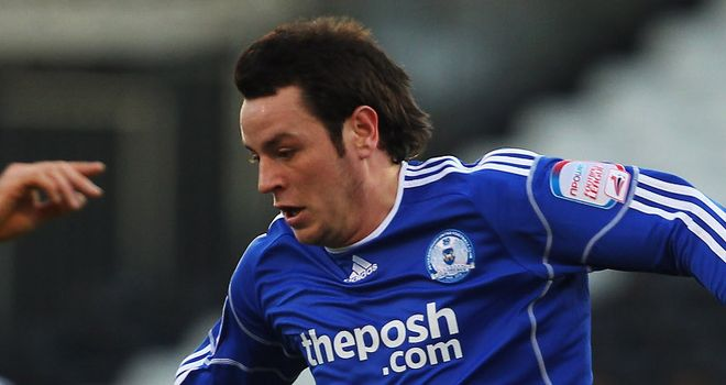 Lee Tomlin: Has been playing for Peterborough through the pain of an ankle ligament injury