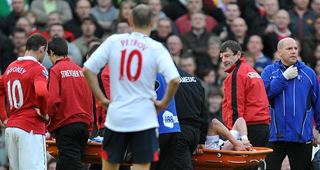 Holden: Stretchered off against Manchester United in March