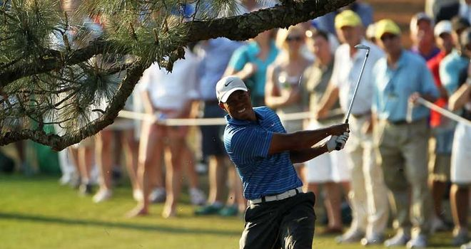 Woods damaged his leg at Augusta