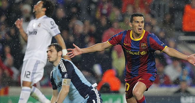 Pedro wheels away after beating Iker Casillas to open the scoring