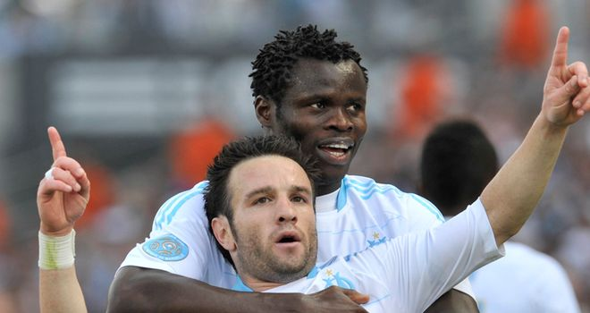 Goal joy: Mathieu Valbuena celebrates with Taye Taiwo after scoring the opener for Marseille in their draw with Auxerre