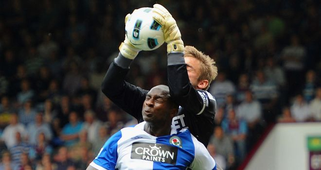 Goalscorer Jason Roberts challenges Robert Green