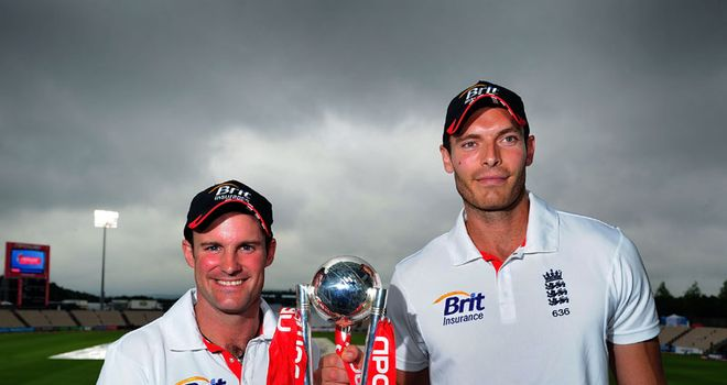 Trophy: Strauss (left) and Tremlett celebrate England's series win