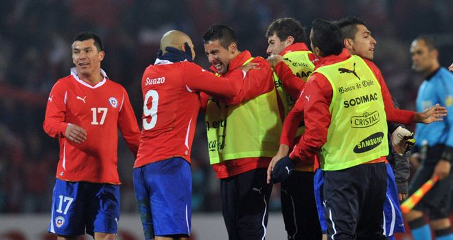 Chile celebrate their late win against Peru