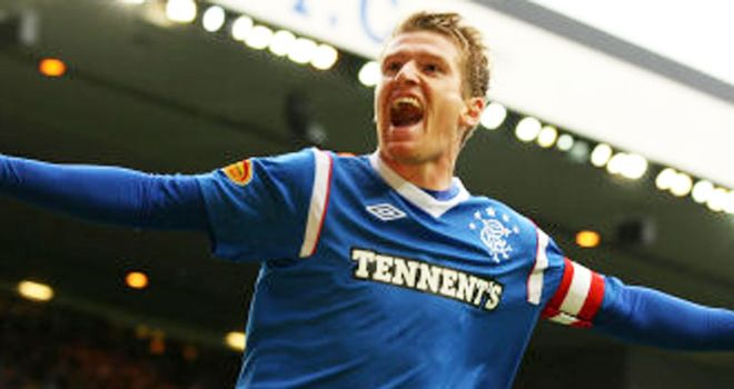 Davis: Celebrates his opener at Ibrox