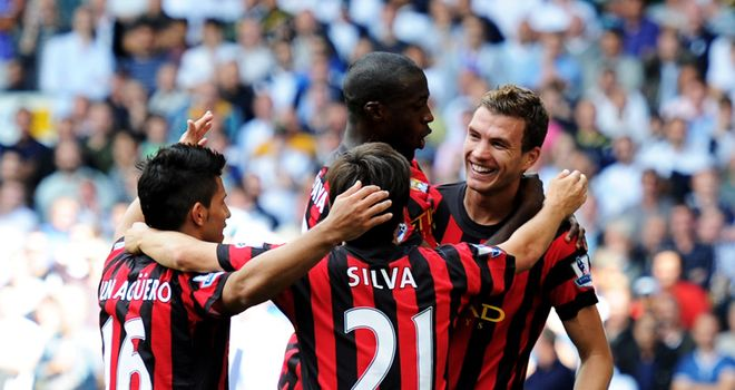 Man City players celebrate with Dzeko after his sensational performance