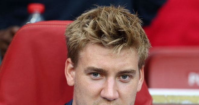 Bendtner: Spotted at Stoke's training ground ahead of possible move away from Arsenal