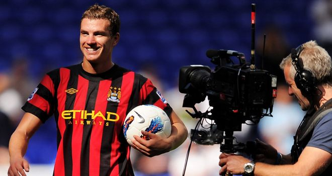 Star man: Dzeko scored four goals for Man City at Spurs