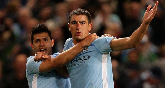 Kolarov is congratulated by Sergio Aguero for his equalising goal