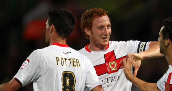 Lewington (centre): Fired in the third for MK Dons