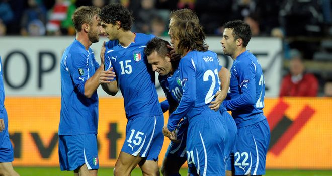 Cassano: Striker is mobbed by his team-mates after his goal put Italy a step closer to Euro 2012 qualification