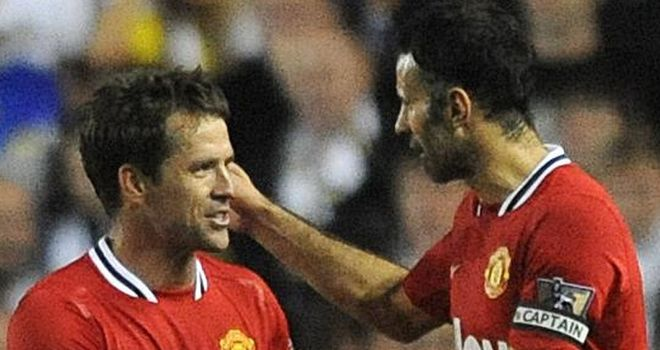 Owen: Celebrates one of his goals with Giggs