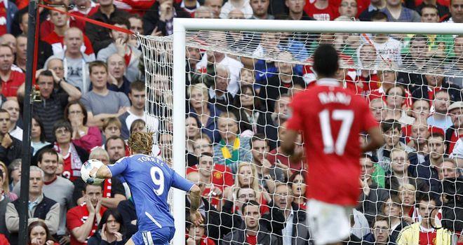 Horrid: Torres fires wide at Old Trafford.