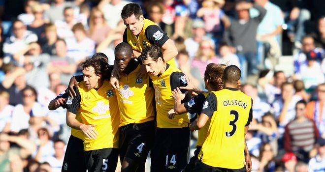 Christopher Samba: The centre-back gets mobbed by his team-mates after his header brought the game level for Blackburn