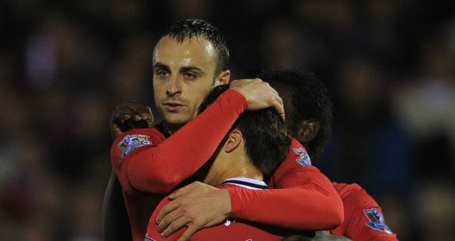 Dimitar Berbatov: Rounded off a flowing move to open the scoring for United