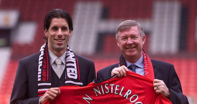 Ruud van Nistelrooy: Poses with Ferguson after signing for United in 2001