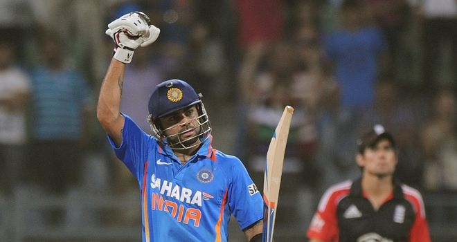 Virat Kohli celebrates his second ODI century against England, and first on Indian soil, in 2011