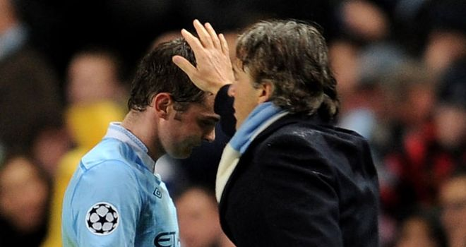 Adam Johnson: The Manchester City winger is continually asked to do more by Roberto Mancini