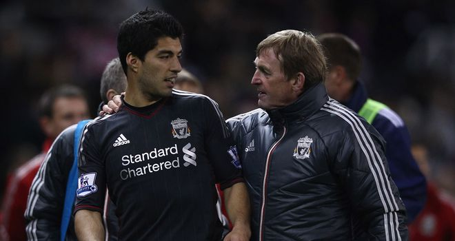 Kenny Dalglish: Remains firmly behind Luis Suarez over the ongoing disciplinary hearing with the FA