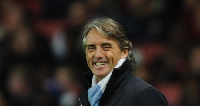 Roberto Mancini: Pleased after watching his side win at the Emirates