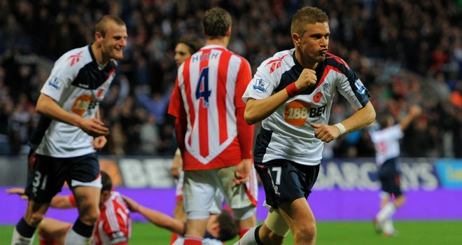 Ivan Klasnic wheels away after heading home Bolton's fifth against Stoke at the Reebok