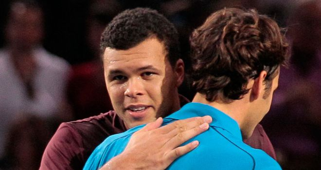 Back in competition: Paris Masters finalists Tsonga and Federer are drawn in Group B
