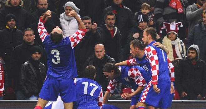 Croatia: Slaven Bilic's men celebrate their emphatic 3-0 first leg win over Turkey