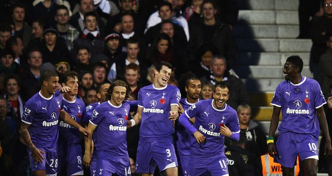 Tottenham Hotspur: Spurs players celebrate Gareth Bale¿s opening goal at Craven Cottage