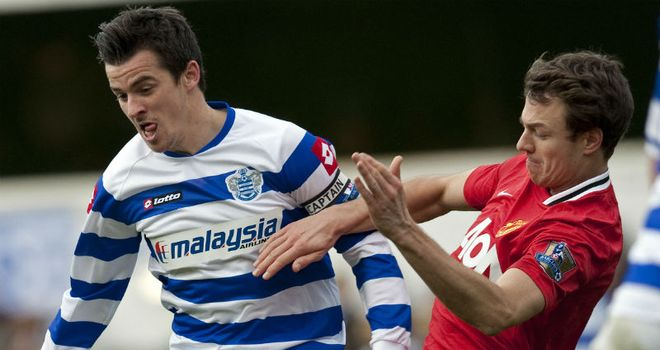 Good battle: Jonny Evans vies with Joey Barton during Manchester United's 2-0 win at QPR