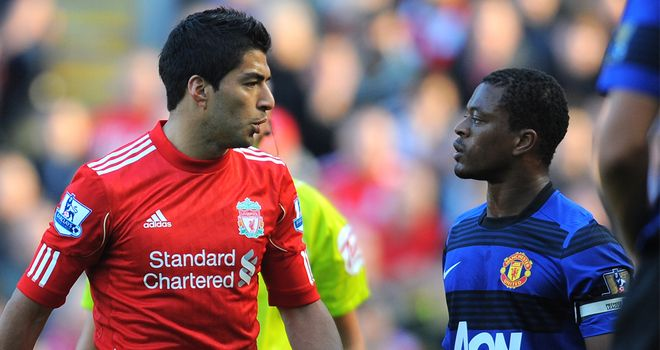 Luis Suarez: Will serve an eight-match ban after being charged with racially abusing Patrice Evra