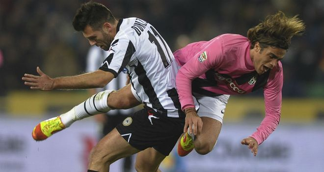 Alessandro Matri of Juventus is tackled by Udinese's Maurizio Domizzi on Wednesday