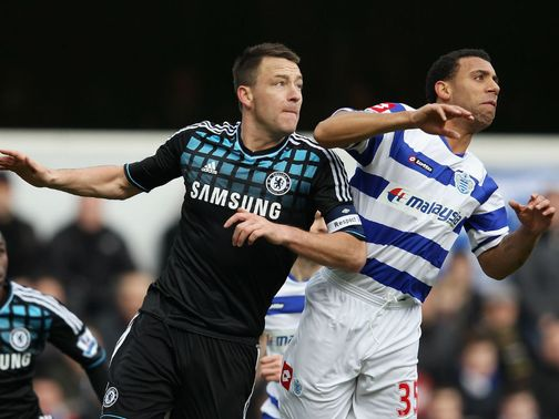 John Terry and Anton Ferdinand vie for the ball